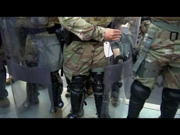 TN National Guardsmen lay down shields at Nashville vigil